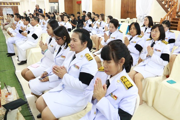 Civil servants pray during the ceremony at the Nongprue municipal office.