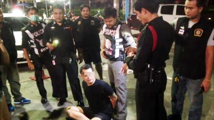 Thechapat Holabuth (seated) and driver Surasak Damrong (not shown) have been charged with drunk driving, disorderly conduct and assaulting a police officer during a highly charged stop at a Pattaya checkpoint.