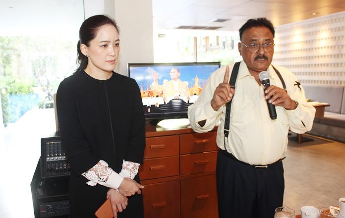 Community organizers Alisa Phanthusak and Peter Malhotra encourage the expat community to join and pay homage to His Majesty King Bhumibol Adulyadej.