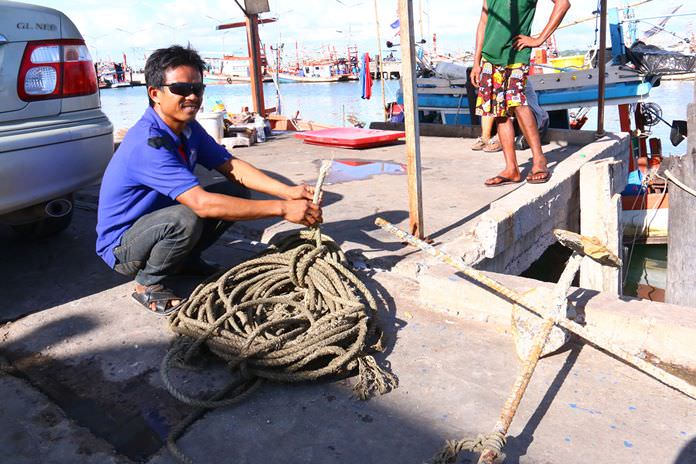 Somai Namwong shows the rope his boat had been tied to before it disappeared to the bottom of Pattaya Bay.
