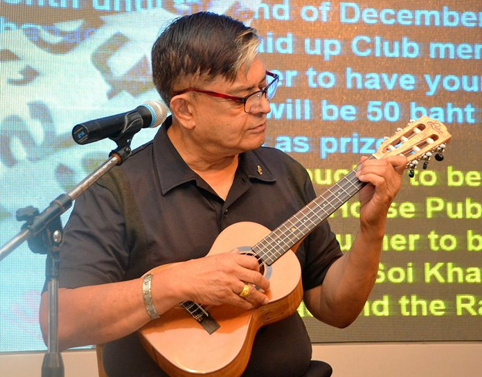 Member Al Serrato entertains his fellows PCEC members with some ukulele music prior to the start of the main program.