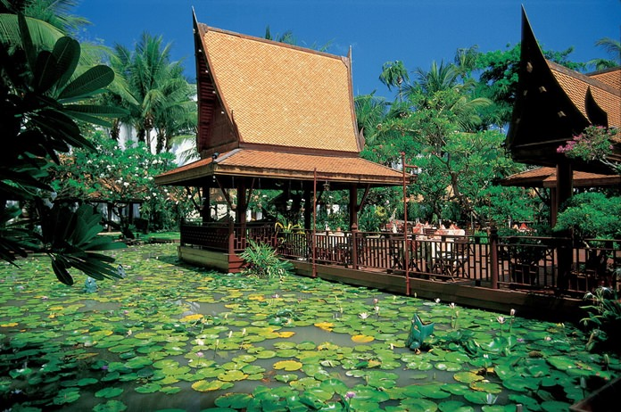 Sala Rim Nam is encircled by lotus ponds and tropical flora.
