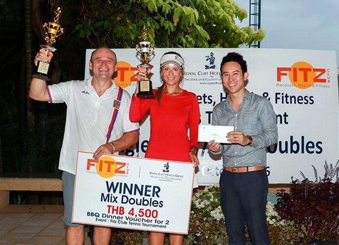 Vitanart Vathanakul (right), Executive Director of the Royal Cliff Hotels Group, presents trophies and prizes to Daniel Rajsky (left) and Anastasia Pimenova, the winners of the Mixed Doubles title at the 8th Fitz Club Tennis Tournament.