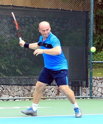 Daniel Rajsky exhibits his tennis prowess during the singles competition.