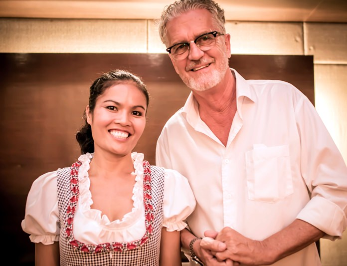 Jo Klemm of GO Property Thailand (right) poses for a photo with a smiling Oktoberfest girl.