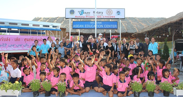The children join the sponsors, Rotarians and teachers for a group photo.