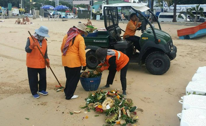 A cleaning crew of about 15 people fanned out across Pattaya and Jomtien beaches Nov. 15, picking up the remnants of the celebration the night before.