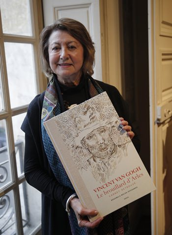 "Art historian and Van Gogh specialist Bogomila Welsh-Ovcharov poses with the book ""Vincent Van Gogh The lost Arles Sketchbook"". (AP Photo/Christophe Ena)"