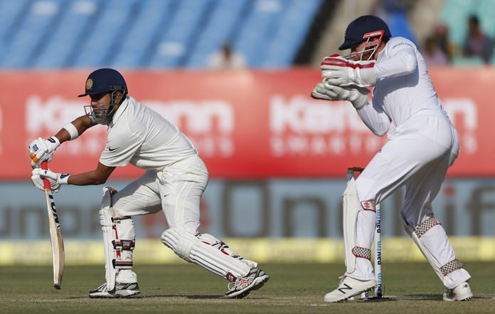 India's Gautam Gambhir, left, bats during the second day of the first test against England in Rajkot, India, Thursday, Nov. 10. (AP Photo/Rafiq Maqbool)