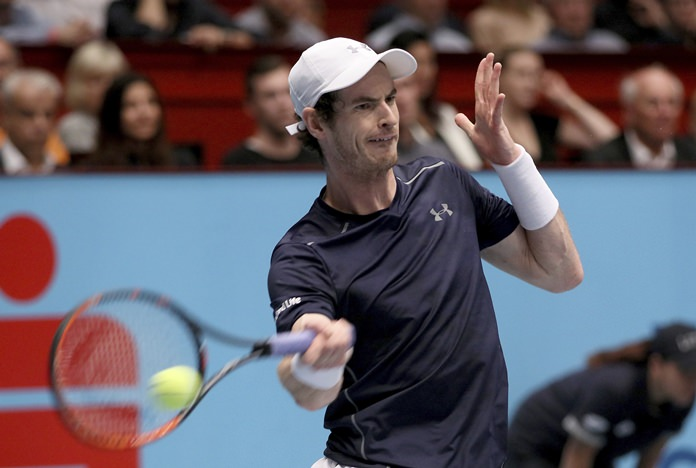 Andy Murray of Great Britain returns the ball to Jo-Wilfried Tsonga of France during the final at the Erste Bank Open tennis tournament in Vienna, Austria, Sunday, Oct. 30. (AP Photo/Ronald Zak)