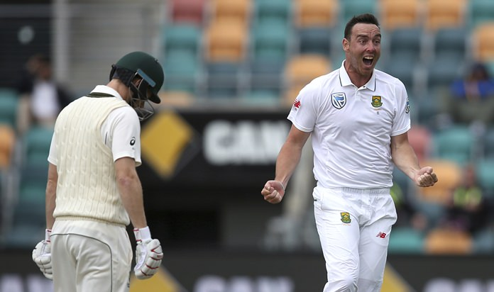 South Africa's Kyle Abbott, right, celebrates after taking the wicket of Australia's Adam Voges, left, during their cricket test match in Hobart, Australia, Tuesday, Nov. 15. (AP Photo/Rick Rycroft)