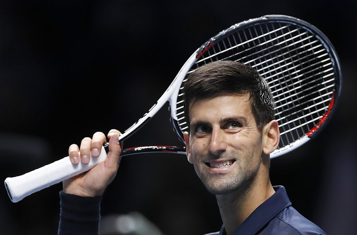 Novak Djokovic of Serbia celebrates winning match point against David Goffin of Belgium during their ATP World Tour Finals singles tennis match at the O2 Arena in London, Thursday, Nov. 17. (AP Photo/Kirsty Wigglesworth)