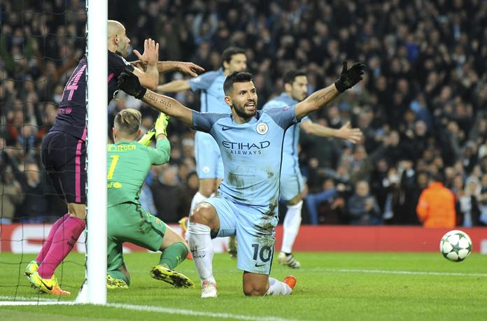 Manchester City's Sergio Aguero celebrates after his teammate Ilkay Gundogan, rear right, scored his side's 3rd goal during their Champions League group C match against Barcelona at the Etihad stadium in Manchester, Tuesday, Nov. 1. (AP Photo/Rui Vieira)