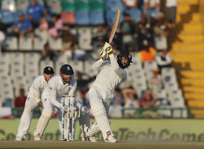India's Ravindra Jadeja hits a six on the second day of the third test against England in Mohali, India, Sunday, Nov. 27. (AP Photo/Altaf Qadri)