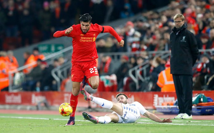 Leeds United's Stuart Dallas, right, and Liverpool's Emre Can battle for the ball, during their English League Cup quarter final match at Anfield Stadium in Liverpool, Tuesday Nov. 29. (Martin Rickett/PA via AP)
