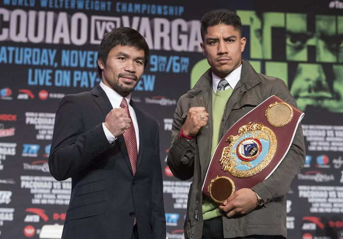 Boxers Manny Pacquiao, left, and Jessie Vargas pose at a news conference Wednesday, Nov. 2, 2016, in Las Vegas, for their Saturday bout for Vargas' WBO welterweight title. (Loren Townsley/Las Vegas Review-Journal via AP)