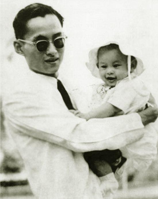Photo of King Rama IX carrying HM King Maha Vajiralongkorn Bodindradebayavarangkun while he was a child.