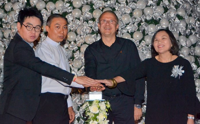(L to R) Former city councilor Rattanachai Sutidechanai, Fr. Peter Pattarapong Sriworakul, president of the Father Ray Foundation, Andre Brulhart, general manager of the Centara Grand Mirage Beach Resort, and Suladda Sarutilavan, director of the TAT Pattaya office join to hit the 'on' button for the big Christmas Tree.