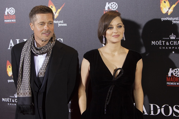 US actor Brad Pitt and French actress Marion Cotillard pose for photographers during a photocall for the premiere of new film 'Allied' in Madrid, Spain Tuesday Nov. 22. (AP Photo/Abraham Caro Marin)