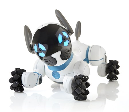 This photo provided by WowWee shows CHiP, a robot dog that cuddles, plays fetch and follows you around the house. (Samuel Pasquier/Ariane Carrier-Cliche/Courtesy of WowWee via AP)
