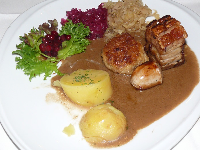 A hearty meal of roast pork.