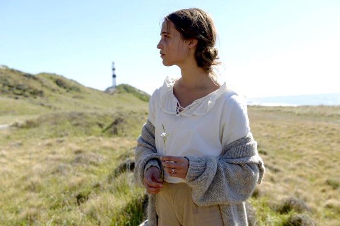 """This image shows Alicia Vikander in a scene from, """"The Light Between Oceans."""" (Davi Russo/Dreamworks II via AP)"""