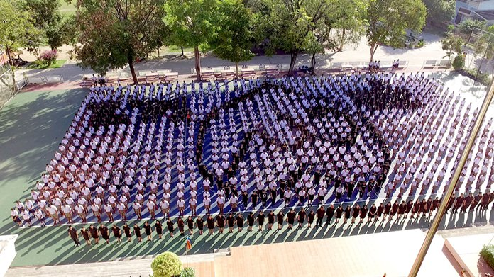 1,300 students and 75 teachers from Plutaluang Wittaya School line up in formation in a giant Thai numeral 9 to pay tribute to HM the late King.