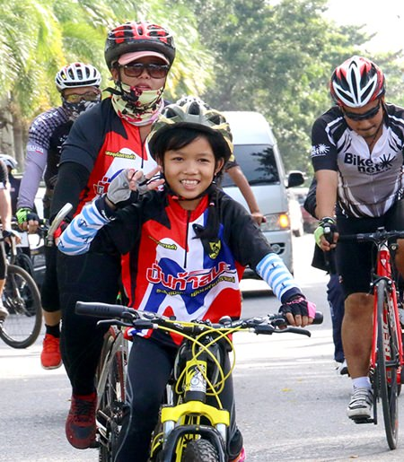 Young and old took to two wheels to celebrate the life of the much revered Thai monarch.