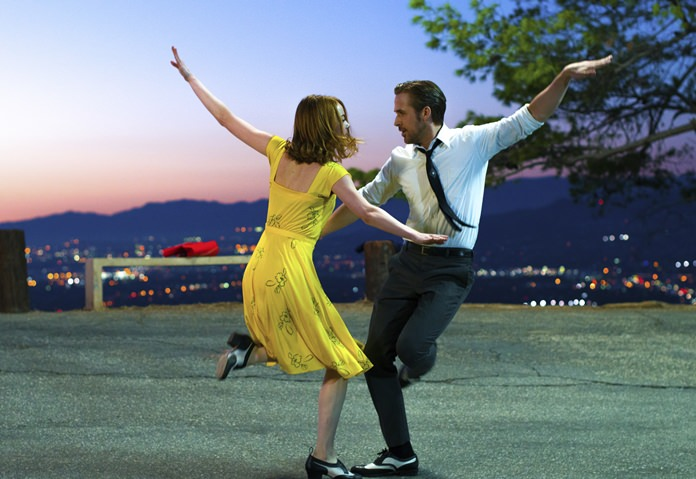 "This image shows Ryan Gosling (right) and Emma Stone in a scene from, ""La La Land."" (Dale Robinette/Lionsgate via AP)"