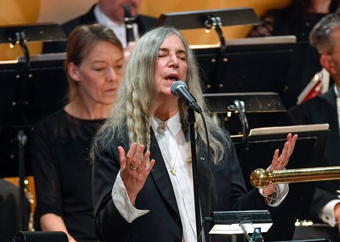 "In this Saturday, Dec. 10, 2016 file photo, US singer Patti Smith performs ""A Hard Rain's A-Gonna Fall"" by absent 2016 Nobel literature laureate Bob Dylan during the 2016 Nobel prize award ceremony at the Stockholm Concert Hall in Sweden. (AP Photo)"