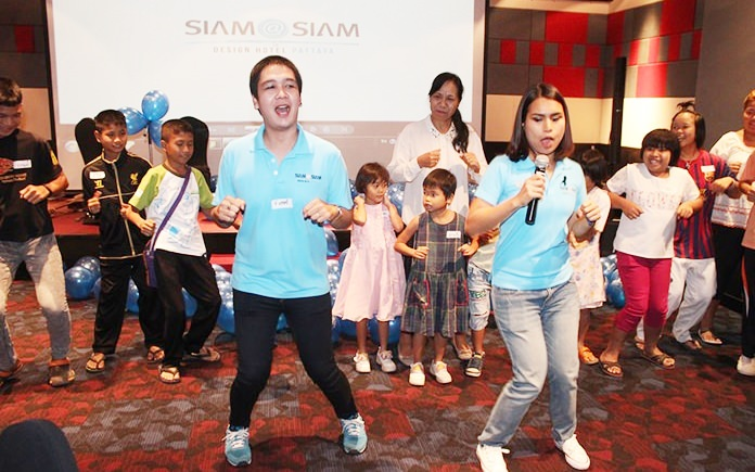 Who's having more fun? The Baan Jing Jai children or the hotel staff?