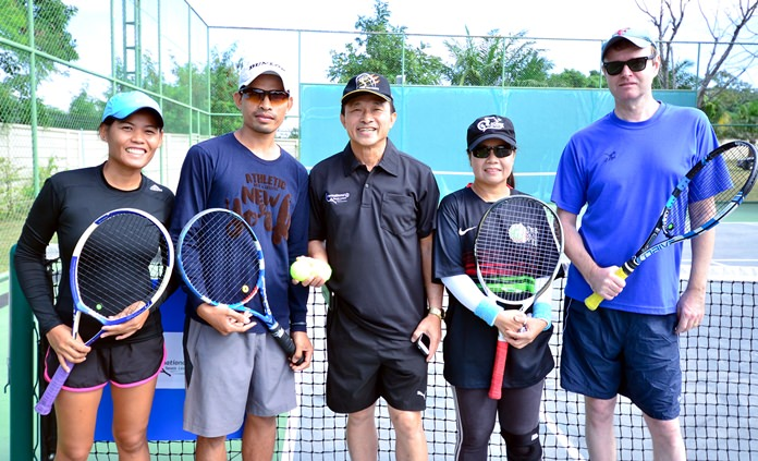 Air Marshall Dr. Channonnat Theplib (centre) officiates the first match of the ITL doubles tournament in Na Jomtien.