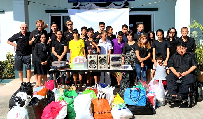Local ITL members make a donation at the Father Ray Foundation children's home in Pattaya.