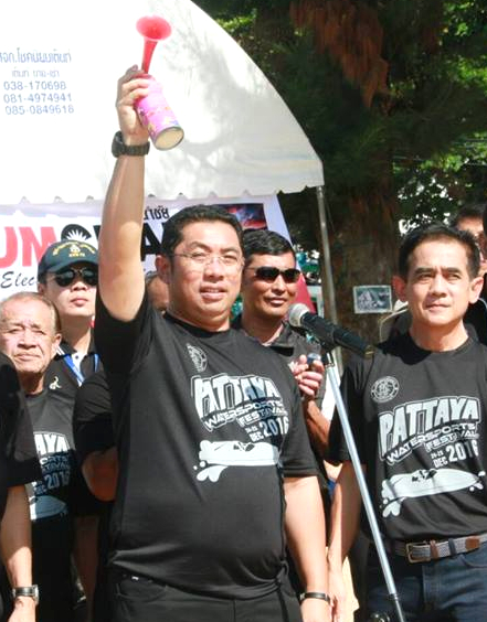 Sontaya Khunplume, president of the Sports Association of Chonburi sounds an air horn to start a race.
