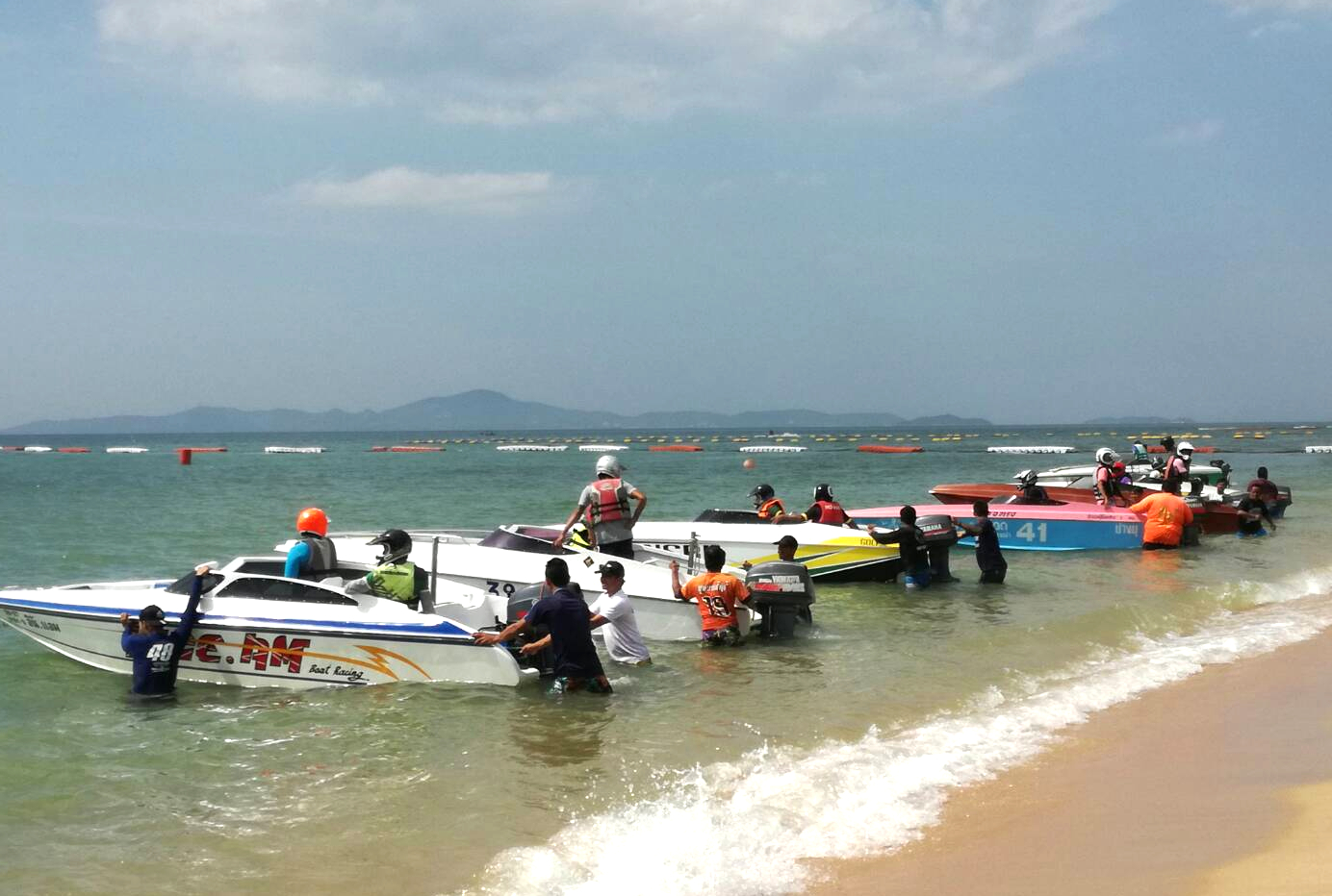 Boats line up on Jomtien beach at the start of another race.