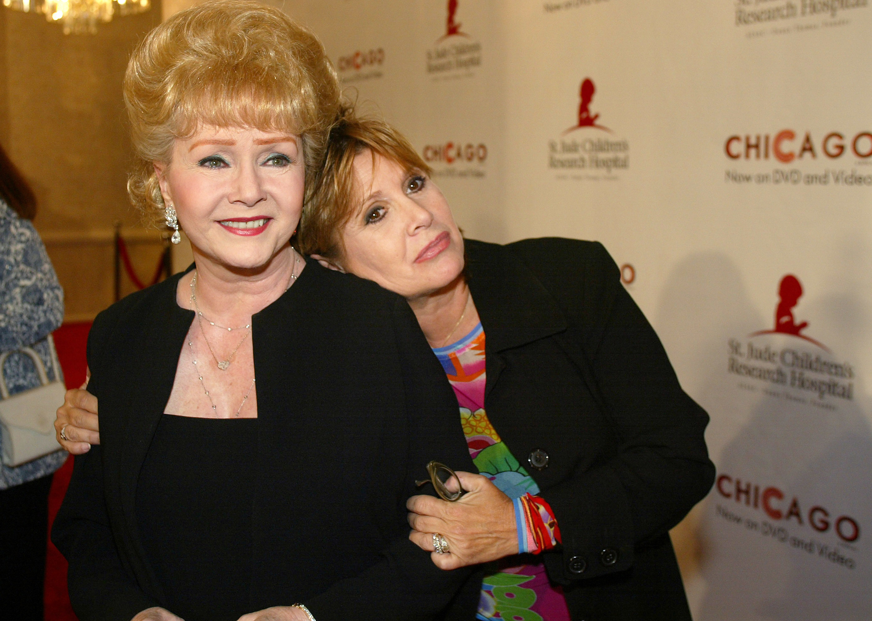 Debbie Reynolds, left, and daughter Carrie Fisher are shown together in this Aug. 19, 2003 file photo. (AP Photo/Jill Connelly)