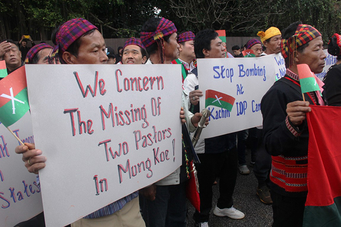 Protestors held signs asking for the investigation into the disappearance of two religious leaders who had been helping journalists report on the attacks in Mong Ko.
