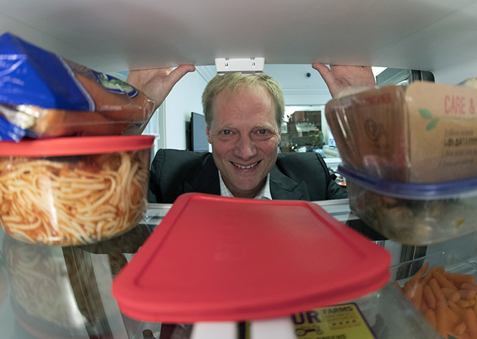 Brian Wansink, a food behavior scientist at Cornell University, says even though it shortens shelf life, move fruits and vegetables out of crisper drawers and put them at eye level. (AP Photo/Mike Groll)