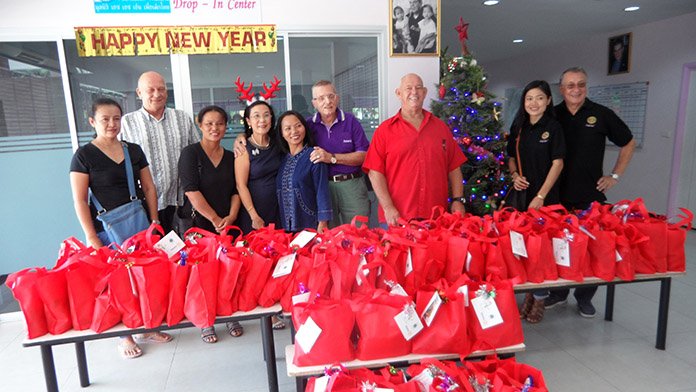The Rotarians brought 80 Christmas bags with them.
