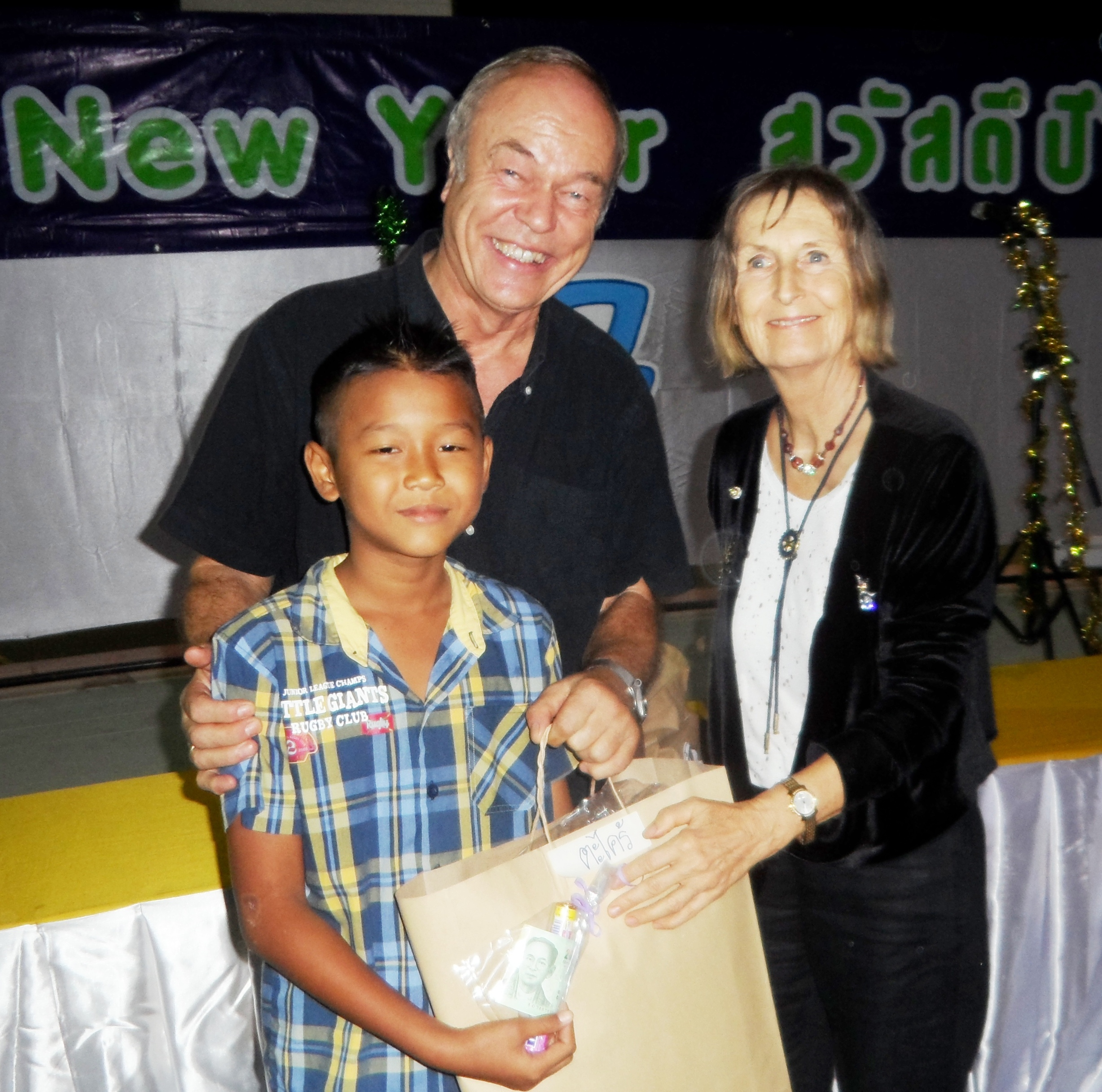 Pastor Liebe and Dr. Margret Deter give presents to the kids.