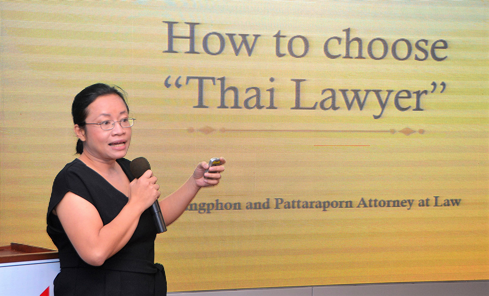 Lawyer Pattaraporn (Oy) Chantaramaha introduces her topic, How to Choose a Thai Lawyer, to her PCEC audience.