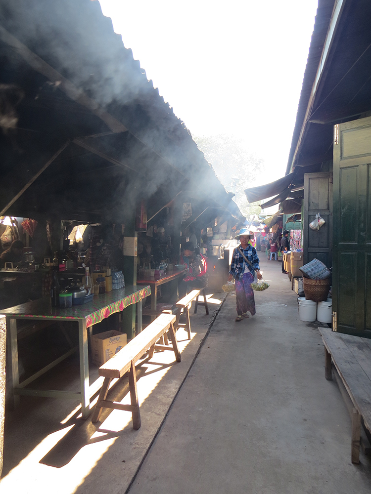 Cooking is all wood fire in the Kengtung Market and the narrow alleys are filled with smoke as people fill up on Shan noodles, baked flatbread and more.