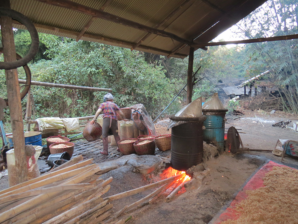 Villagers brew rice whiskey the old fashioned way.