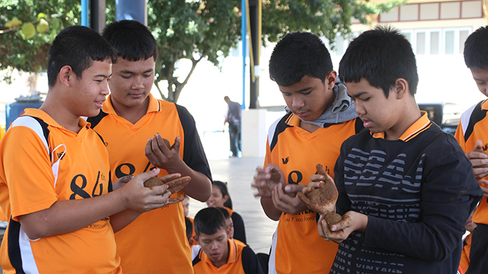 Nong Ket Yai students are shown how to make 2,500 effective-microorganism balls to consume the sewage polluting the lake.