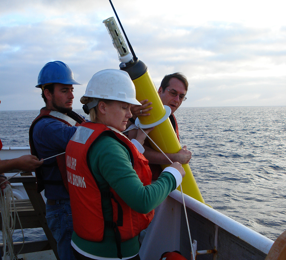 This photo provided by NOAA Corps shows the deploying an Argo float to capture ocean temperature data. A new independent study shows no pause in global warming, confirming a set of temperature readings adjusted by U.S. government scientists that some who reject mainstream climate science have questioned. (NOAA Corps, Lt. Elizabeth Crapo via AP)