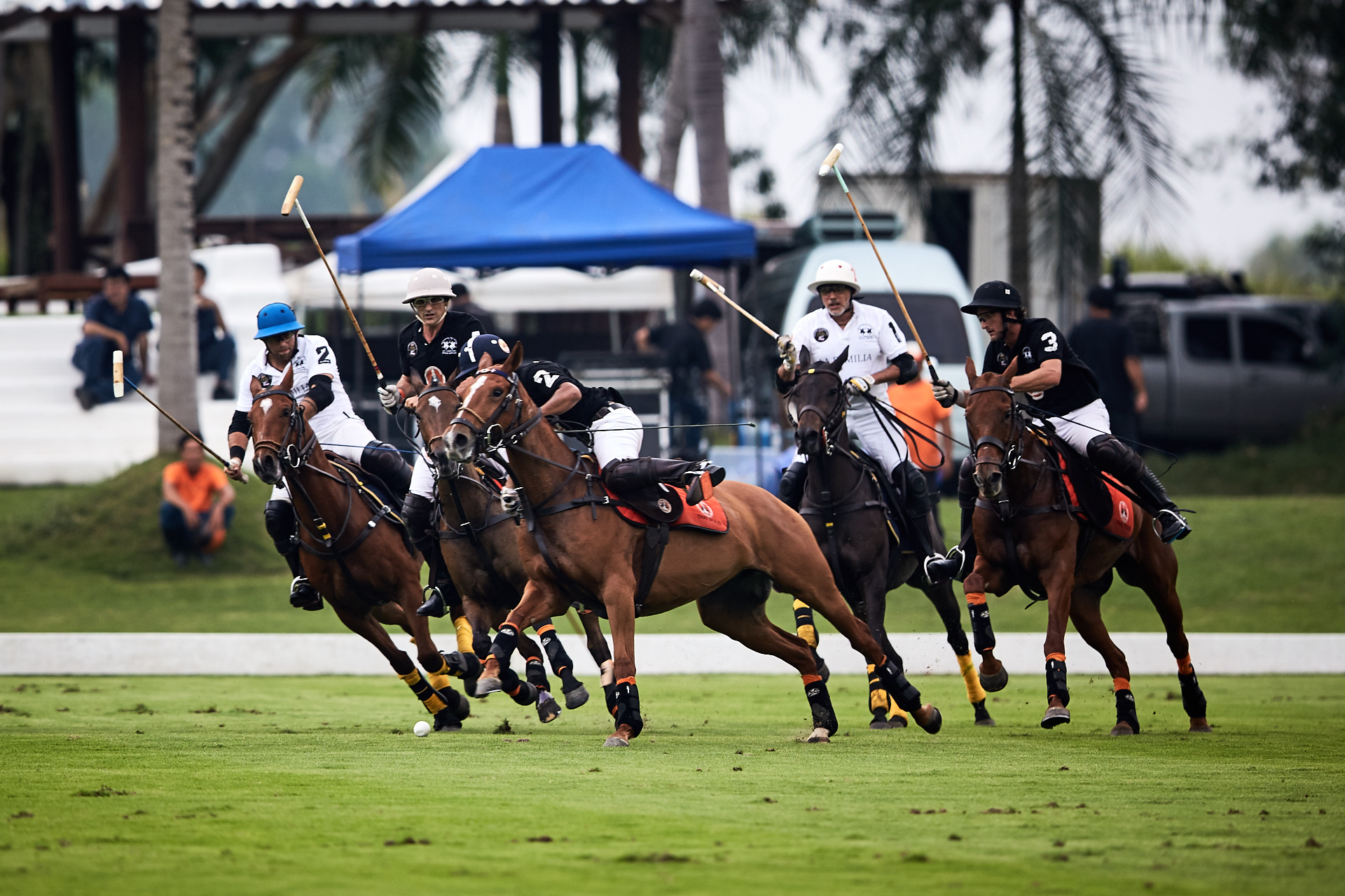Thai Polo and La Familia players battle for possession during the first chukka of the final.