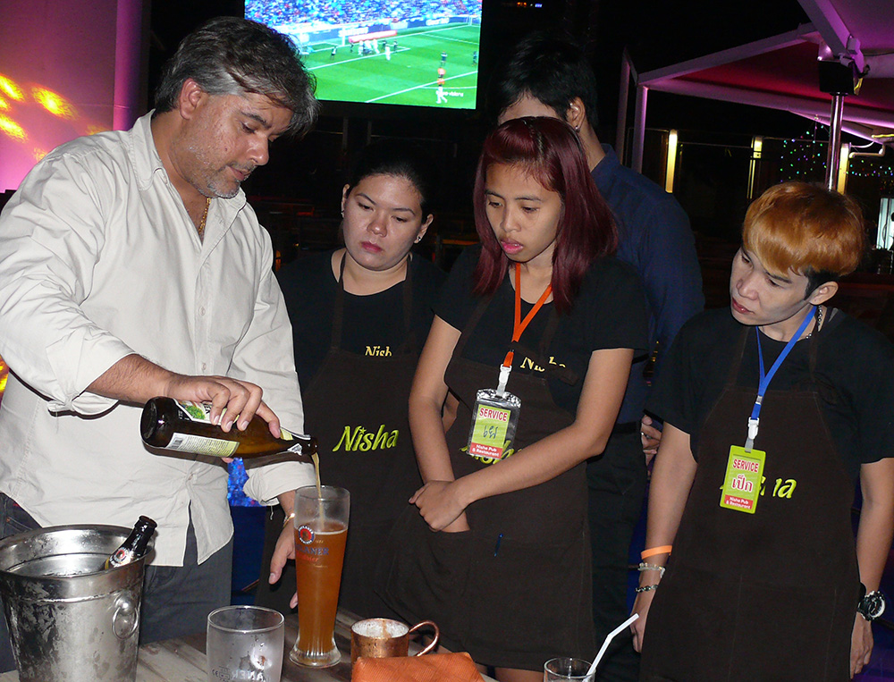 Tony demonstrates the fine art of pouring a Paulaner Hefe-Weissbier.