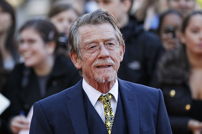 "This Sep. 13, 2011 file photo shows British actor John Hurt arriving for the UK film premiere of ""Tinker Tailor Soldier Spy"" at the BFI Southbank in London. Hurt, who battled pancreatic cancer, passed away Friday, Jan. 27. (AP Photo/Sang Tan)"