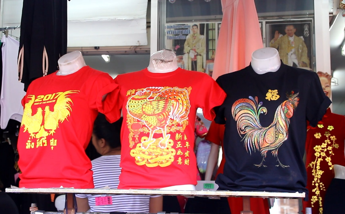 With most Thais still wearing black, brilliant red and gold qipao dresses didn't sell well for Chinese New Year.