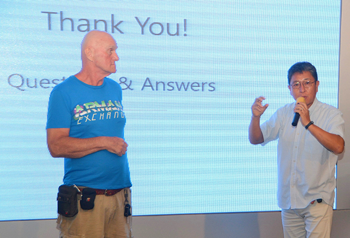 Chris Harmon and Seong Bao Jo answer questions from the audience.